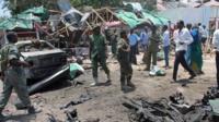 Somali soldiers gather near Village restaurant following blast