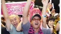 Japanese supporters of the Tokyo bid 2020 team celebrate in Tokyo