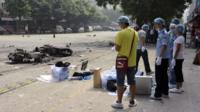 "Investigators go through the site of an explosion outside Balijie Primary School in Lingchuan county in south China""s Guangxi Zhuang"
