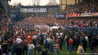 Fans on pitch