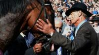 Trainer Henry Cecil greets Frankel after his victory in the Juddmonte International Stakes