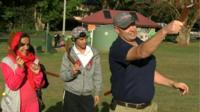 Family learning to throw boomerang