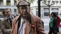 British horse racing pundit John McCririck arrives at an employment tribunal in London October 1,