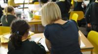 Teaching assistant and pupil