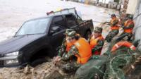 Vehicle pulled from flood waters