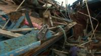 Wrecked boats lie in Lampedusa port