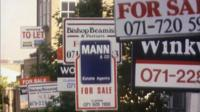 For sale signs on houses