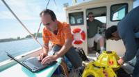 Researchers from the University of Buffalo on a boat
