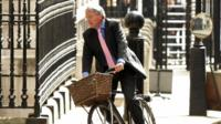 Andrew Mitchell on his bicycle in Whitehall