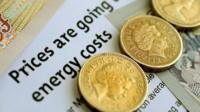 Pound coins on energy bill
