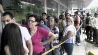 Shoppers queuing