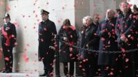 Poppies fall during ceremony at the Menin Gate