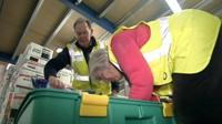 Man and woman pack aid box