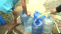 Water cans being filled