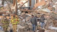 Firefighters survey debris in Devonshire Street , Washington, Illinois
