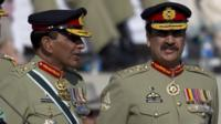 "Pakistan""s outgoing army chief Gen. Ashfaq Kayani, left, talks with his successor Gen. Raheel Shari"