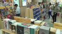 people in Indian bookshop