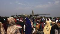 People waiting to be evacuated at the airport
