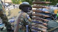 South Sudan army soldier with a machine gun