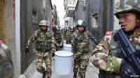 Paramilitary policemen carry seized crystal meth at Boshe village