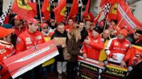 Ferrari fans outside the hospital where Michael Schumacher is being treated