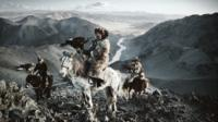 Kazakh eagle hunters on horseback