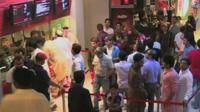 People queuing up to buy cinema tickets at a multiplex in Pakistan