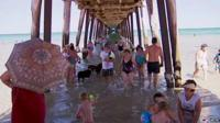 People under jetty on beach in Adelaide