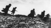 Soldiers going over the top in World War One