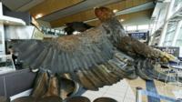 Eagle sculpture on airport floor