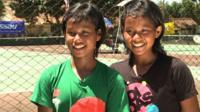 Young Indonesian tennis playing twins Fitriani Sabatini (green, left) and Fitriana Sabrina Mastuti