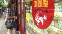 Woman outside 'Casa China' shop