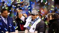 Seattle Seahawks quarterback Russell Wilson celebrates with the Vince Lombardi Trophy after beating Denver Broncos in Super Bowl XLVIII