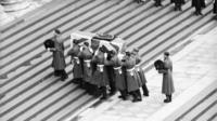 Soldiers carry coffin of Sir Winston Churchill up steps of St Paul's 1965