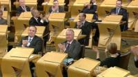 First Minister Alex Salmond was among the MSPs applauding
