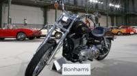 "The 1,585 cc Harley Davidson Dyna Super Glide, donated to Pope Francis last year and signed by him on its tank, is displayed as part of Bonham""s Les Grandes Marques du Monde vintage and classic cars sale at the Grand Palais in Paris"