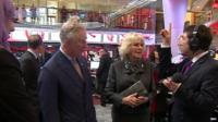 Presenter Ros Atkins talking to Prince Charles and Camilla on visit to New Broadcasting House