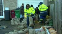 Volunteers filling sandbags