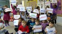 School children with printed messages