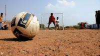 Football and boy in goal
