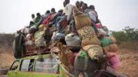 A vehicle loaded with people and their possessions fleeing CAR to Cameroon