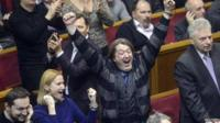 """Ukraine""""s opposition members react during a Parliament session in Kiev"""