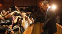 Cameras photograph Pistorius