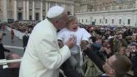 Pope Francis meets child dressed as him