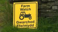 Farm Watch sign