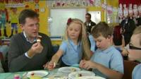 Nick Clegg eating with schoolchildren