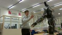 Man demonstrating robot