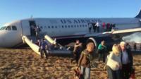 Passengers leaving the plane