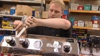 A man works on a coffee machine