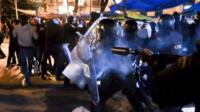 Demonstrators clash with anti-riot police officers at the end of a march against austerity in Madrid in Spain